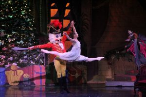 Clara and Nutcracker performing on stage